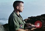 Image of U.S. army chaplain leads service Vietnam, 1968, second 49 stock footage video 65675021201