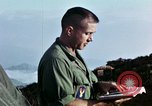 Image of U.S. army chaplain leads service Vietnam, 1968, second 53 stock footage video 65675021201