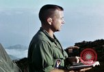 Image of U.S. army chaplain leads service Vietnam, 1968, second 56 stock footage video 65675021201