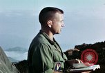 Image of U.S. army chaplain leads service Vietnam, 1968, second 57 stock footage video 65675021201