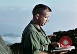 Image of U.S. army chaplain leads service Vietnam, 1968, second 58 stock footage video 65675021201