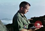 Image of U.S. army chaplain leads service Vietnam, 1968, second 59 stock footage video 65675021201