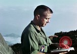 Image of U.S. army chaplain leads service Vietnam, 1968, second 60 stock footage video 65675021201
