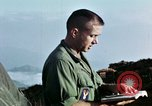 Image of U.S. army chaplain leads service Vietnam, 1968, second 61 stock footage video 65675021201