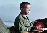 Image of U.S. army chaplain leads service Vietnam, 1968, second 62 stock footage video 65675021201