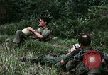Image of US Army 196th Light Infantry Brigade soldiers rest Vietnam, 1968, second 16 stock footage video 65675021202