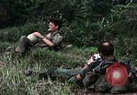 Image of US Army 196th Light Infantry Brigade soldiers rest Vietnam, 1968, second 17 stock footage video 65675021202