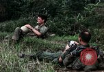 Image of US Army 196th Light Infantry Brigade soldiers rest Vietnam, 1968, second 18 stock footage video 65675021202