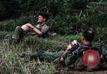 Image of US Army 196th Light Infantry Brigade soldiers rest Vietnam, 1968, second 19 stock footage video 65675021202