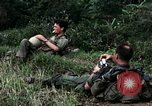 Image of US Army 196th Light Infantry Brigade soldiers rest Vietnam, 1968, second 20 stock footage video 65675021202