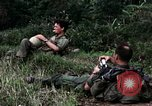 Image of US Army 196th Light Infantry Brigade soldiers rest Vietnam, 1968, second 21 stock footage video 65675021202
