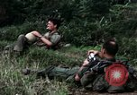 Image of US Army 196th Light Infantry Brigade soldiers rest Vietnam, 1968, second 22 stock footage video 65675021202