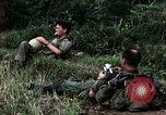 Image of US Army 196th Light Infantry Brigade soldiers rest Vietnam, 1968, second 23 stock footage video 65675021202