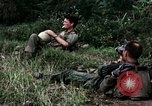 Image of US Army 196th Light Infantry Brigade soldiers rest Vietnam, 1968, second 24 stock footage video 65675021202