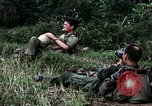 Image of US Army 196th Light Infantry Brigade soldiers rest Vietnam, 1968, second 25 stock footage video 65675021202