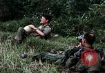 Image of US Army 196th Light Infantry Brigade soldiers rest Vietnam, 1968, second 26 stock footage video 65675021202
