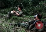 Image of US Army 196th Light Infantry Brigade soldiers rest Vietnam, 1968, second 27 stock footage video 65675021202