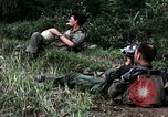 Image of US Army 196th Light Infantry Brigade soldiers rest Vietnam, 1968, second 31 stock footage video 65675021202