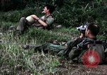 Image of US Army 196th Light Infantry Brigade soldiers rest Vietnam, 1968, second 33 stock footage video 65675021202