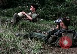 Image of US Army 196th Light Infantry Brigade soldiers rest Vietnam, 1968, second 34 stock footage video 65675021202