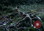 Image of US Army 196th Light Infantry Brigade soldiers rest Vietnam, 1968, second 38 stock footage video 65675021202