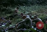Image of US Army 196th Light Infantry Brigade soldiers rest Vietnam, 1968, second 39 stock footage video 65675021202