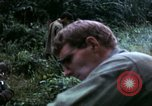 Image of US Army 196th Light Infantry Brigade soldiers rest Vietnam, 1968, second 50 stock footage video 65675021202