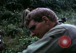 Image of US Army 196th Light Infantry Brigade soldiers rest Vietnam, 1968, second 51 stock footage video 65675021202