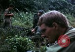 Image of US Army 196th Light Infantry Brigade soldiers rest Vietnam, 1968, second 58 stock footage video 65675021202