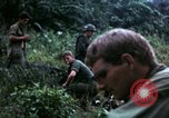 Image of US Army 196th Light Infantry Brigade soldiers rest Vietnam, 1968, second 61 stock footage video 65675021202
