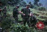 Image of US Army 196th Light Infantry Brigade soldiers rest Vietnam, 1968, second 62 stock footage video 65675021202