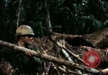 Image of U.S. soldiers dismantle and burn NVA huts in village Vietnam, 1968, second 34 stock footage video 65675021203