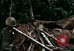 Image of U.S. soldiers dismantle and burn NVA huts in village Vietnam, 1968, second 36 stock footage video 65675021203