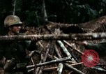 Image of U.S. soldiers dismantle and burn NVA huts in village Vietnam, 1968, second 38 stock footage video 65675021203