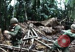 Image of U.S. soldiers dismantle and burn NVA huts in village Vietnam, 1968, second 42 stock footage video 65675021203