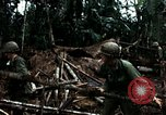 Image of U.S. soldiers dismantle and burn NVA huts in village Vietnam, 1968, second 47 stock footage video 65675021203