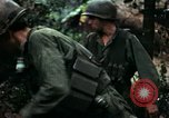 Image of U.S. soldiers dismantle and burn NVA huts in village Vietnam, 1968, second 61 stock footage video 65675021203