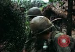 Image of U.S. soldiers dismantle and burn NVA huts in village Vietnam, 1968, second 62 stock footage video 65675021203