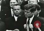Image of John Fitzgerald Kennedy presentation to Major Cooper United States USA, 1963, second 4 stock footage video 65675021468