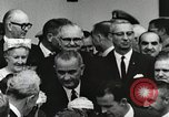 Image of John Fitzgerald Kennedy presentation to Major Cooper United States USA, 1963, second 54 stock footage video 65675021468