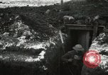 Image of US Army soldiers prepare for gas attack in World War 1 trench France, 1918, second 10 stock footage video 65675021500