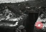 Image of US Army soldiers prepare for gas attack in World War 1 trench France, 1918, second 11 stock footage video 65675021500