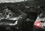 Image of US Army soldiers prepare for gas attack in World War 1 trench France, 1918, second 14 stock footage video 65675021500