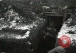 Image of US Army soldiers prepare for gas attack in World War 1 trench France, 1918, second 15 stock footage video 65675021500