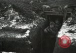 Image of US Army soldiers prepare for gas attack in World War 1 trench France, 1918, second 17 stock footage video 65675021500