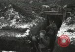 Image of US Army soldiers prepare for gas attack in World War 1 trench France, 1918, second 18 stock footage video 65675021500