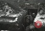 Image of US Army soldiers prepare for gas attack in World War 1 trench France, 1918, second 19 stock footage video 65675021500