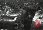 Image of US Army soldiers prepare for gas attack in World War 1 trench France, 1918, second 20 stock footage video 65675021500