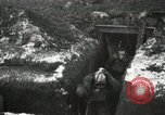 Image of US Army soldiers prepare for gas attack in World War 1 trench France, 1918, second 21 stock footage video 65675021500