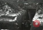 Image of US Army soldiers prepare for gas attack in World War 1 trench France, 1918, second 22 stock footage video 65675021500